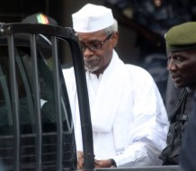 Former Chadian dictator Hissene Habre is escorted by military officers  after being heard by judge on July 2, 2013 in Dakar. Senegalese authorities charged Hissene Habre with genocide and crimes against humanity and remanded him in custody on Tuesday in a prosecution seen by many as a milestone for African justice. The 70-year-old was also charged with war crimes and torture during his eight years in power in Chad, where rights groups say 40,000 people were killed under his rule, a court source and his lawyers told AFP.   AFP PHOTO / STRINGER        (Photo credit should read STRINGER/AFP/Getty Images)