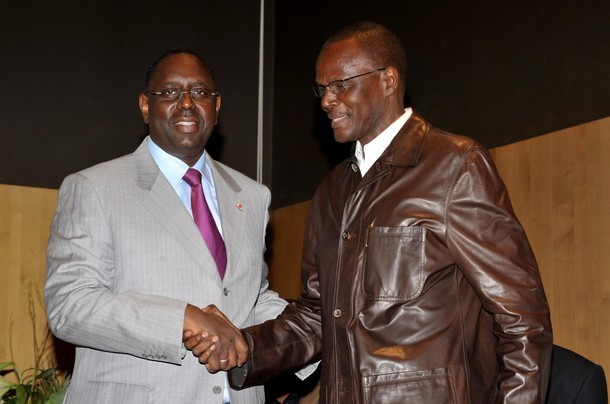 Senegalese opposition candidate Macky Sall  (L) shakes hands on March 10,  2012 with opposition leader Ousmane Tanor Dieng at a hotel in Dakar before a press conference. Senegal's opposition leaders joined forces on March 10, creating the Gathering of Forces for Change, to support Sall to unseat incumbent Abdoulaye Wade in a run-off election on March 25.                      AFP PHOTO / SEYLLOU (Photo credit should read SEYLLOU/AFP/Getty Images)