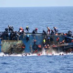 "This handout picture released on May 25, 2016 by the Italian Navy (Marina Militare) shows the shipwreck of an overcrowded boat of migrants off the Libyan coast today. At least seven migrants have drowned after the heavily overcrowded boat they were sailing on overturned, the Italian navy said. The navy said 500 people had been pulled to safety and seven bodies recovered, but rescue operations were continuing and the death toll could rise.  The navy's Bettica patrol boat spotted ""a boat in precarious conditions off the coast of Libya with numerous migrants aboard,"" it said in a statement. / AFP PHOTO / MARINA MILITARE AND AFP PHOTO / STR / RESTRICTED TO EDITORIAL USE - MANDATORY CREDIT ""AFP PHOTO / MARINA MILITARE"" - NO MARKETING NO ADVERTISING CAMPAIGNS - DISTRIBUTED AS A SERVICE TO CLIENTS"